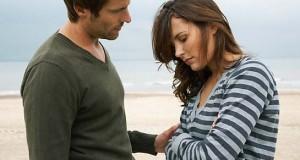 700-01082859© MasterfileModel ReleaseMan Consoling Woman on Beach